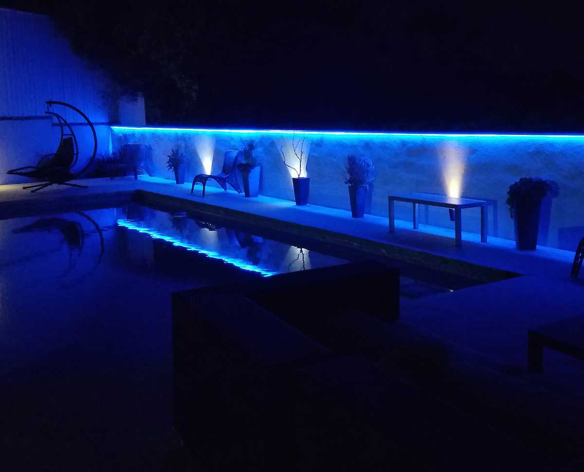 blue outdoor poolside accent lighting